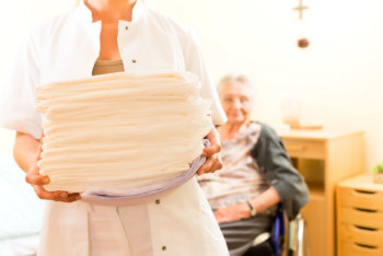 caregiver carrying bed cloth