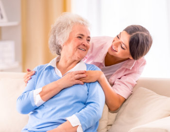 caregiver and an elderly smiling